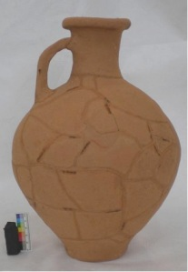 image of terracotta flagon with gaps filled but still visible so that the individual sherds are noticable in the finished object