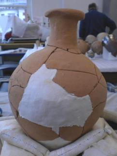 Image showing the missing are of pot now filled with white plaster